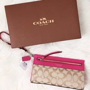 Brand new Coach Legacy wristlet in large