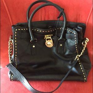Michael Kors black and gold bag