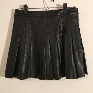 Never worn black faux leather pleated mini skirt