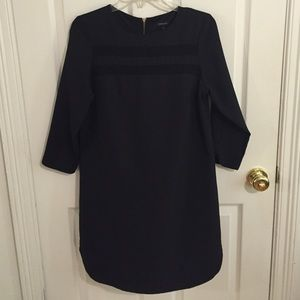 Black shift dress with see through details