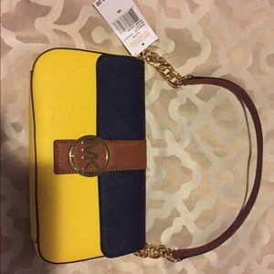 Michael Kors (authentic) tags attached clutch