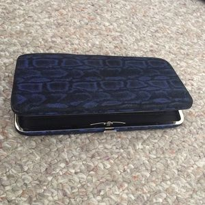 Blue and black snake skin clutch