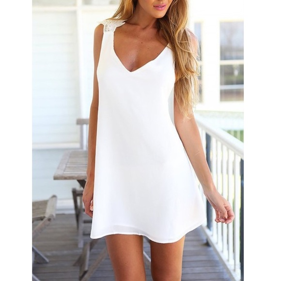 4a410cfedeb White lace criss cross back mini dress
