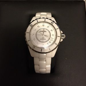 Chanel J12 Watch With Diamonds in face.