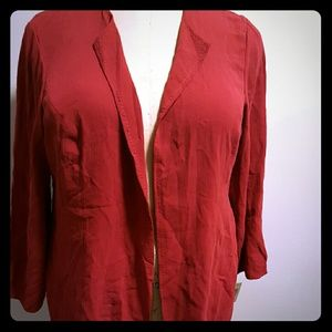 Red pebbled crep silk jacket with stitch detail