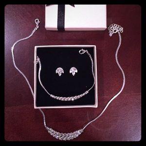 Avon necklace, bracelet and earrings set.