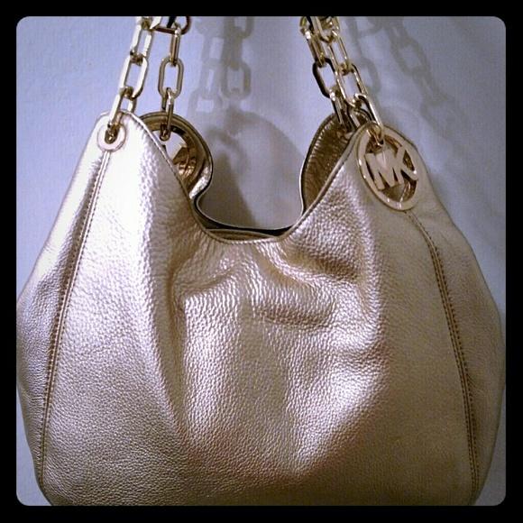 7ab5375d844e Michael Kors Large Fulton Gold Leather handbag. M_5594b9755020b91969001a6f