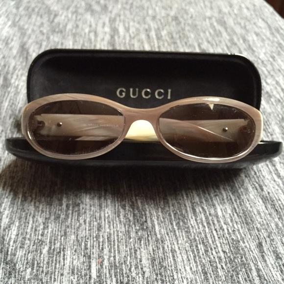 bf26bd050c4 Gucci Accessories - Gucci small frame sunglasses with pearl finish.
