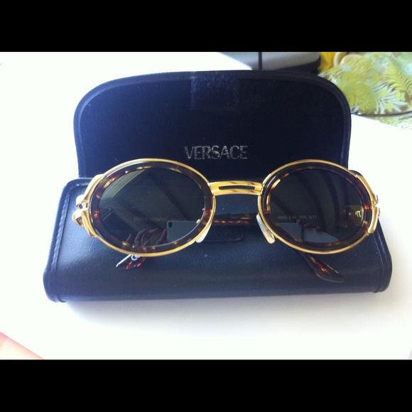 9cb80774cb Vintage Versace gold-tone tortoise sunglasses. M 5599b3c4c402ae7efb00f12d