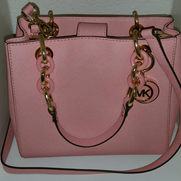 59d1d2621123 Michael kors light pink cross body bag