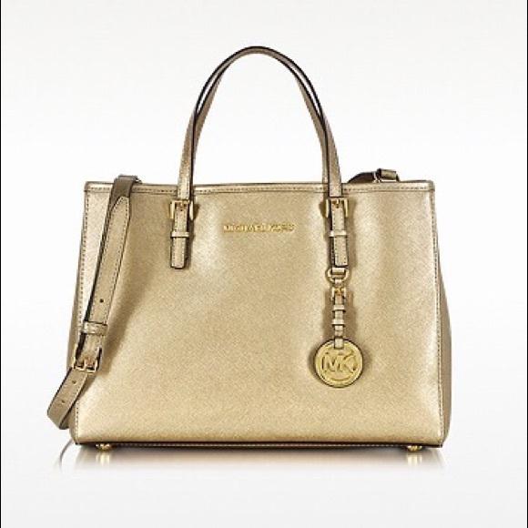 Gold Michael Kors bag. M 559abd1b2ec0e14f1c013716 bb794767b9400