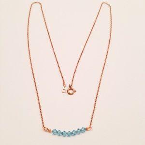 Jewelry - swarovski crystal.delicate gold & blue aquamarine