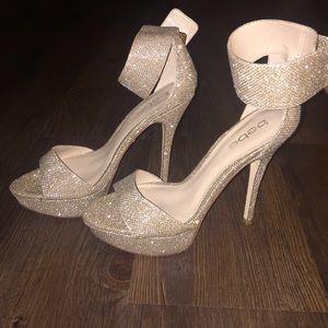 Gold shimmer ankle strap platform pumps