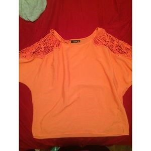 Peachy colored blouse.