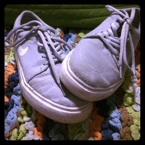 A grey pair of Nike  sneakers