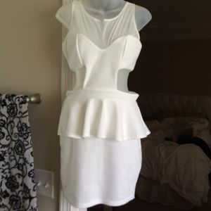 White Peplum dress with mesh top and side cut outs