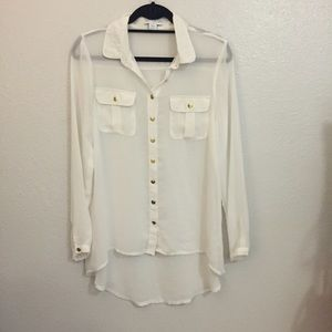 Sheer blouse with gold buttons