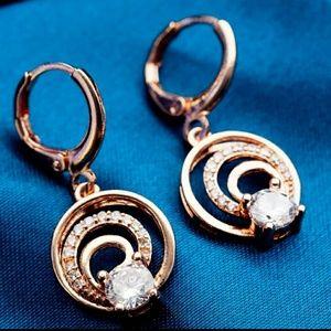 Rose gold earrings of gathering