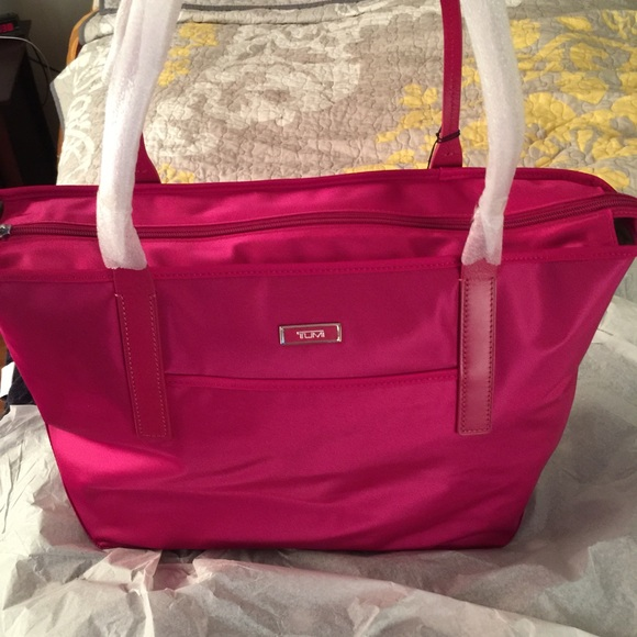 67% off Tumi Handbags - Tumi Pink handbag. SALE. 🎈🎈🎈 from ...