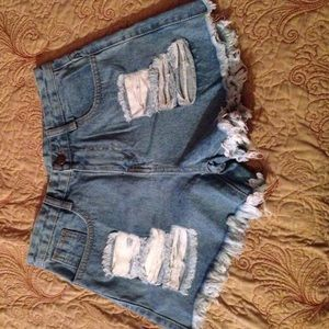 Denim - Distressed slightly high waisted shorts.