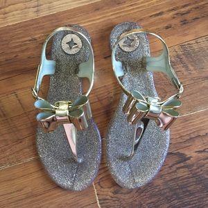 02851509d3f7 BCBGeneration Shoes - BCBG Generation Gold Bow Sandals Jellies 5