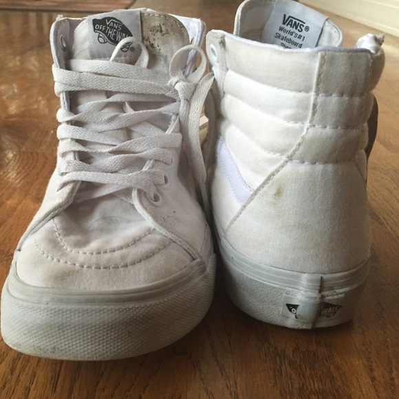 beige and white high top vans