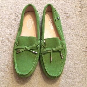 Green suede loafers with leather lining.