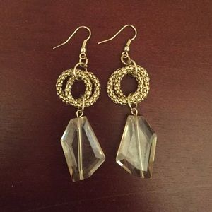 Gold drop earrings with stone.