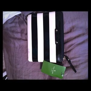 Black and white stripped Kate spade mini pouch