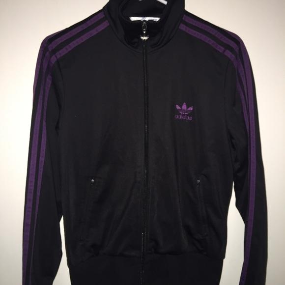 Adidas black track jacket with purple details.