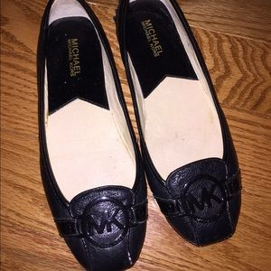 Michael kors flat black shoes.