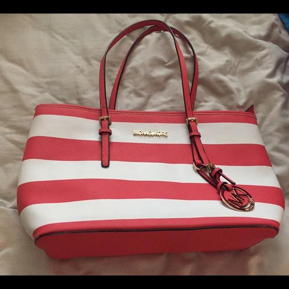 59% off Michael Kors Handbags - Pink and white Michael Kors purse ...