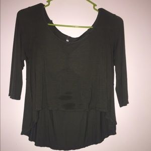 Forest green hi-low crop top, open back.