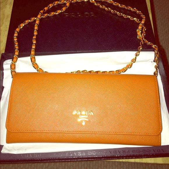 c12ad7d29ece Saffiano orange leather wallet with chain. M_55b44c66dbda257366007ac5