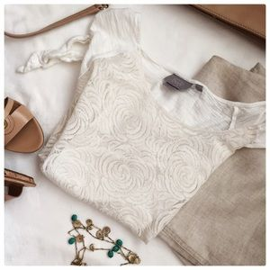 Cream rosette lace cap sleeve top