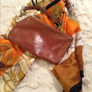 Clutches & Wallets - Leather clutch bag.
