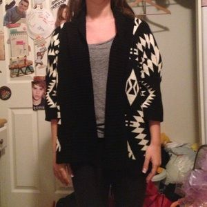 An oversize black and white cardigan.