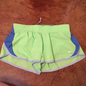 Green and blue Nike dri-fit running shorts