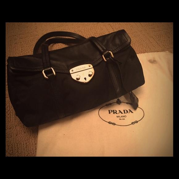 95abc52f34de8f Prada Bags | Black Leather And Nylon Handbag With Lock | Poshmark