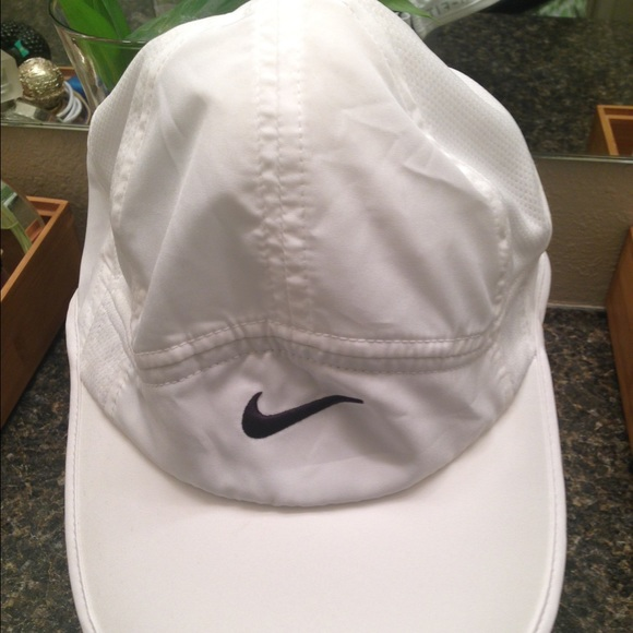 a9cb2e8aa5e8f Nike Dri-Fit Featherlight Hat (womens). M 55b7cb292ec0e11ebf018c4f. Other  Accessories ...