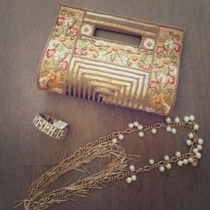 Golden hand embroidered clutch