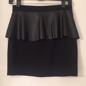 Must have black skirt w/ faux leather detail!