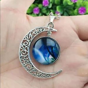 Glass Hollow half moon necklace.