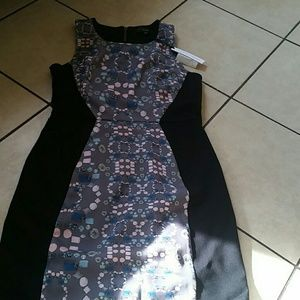 Slimming black dress with pattern and cutout back