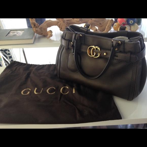 8da59688d35 Gucci Handbags - Gucci handbag gg running tote Marmont buckle