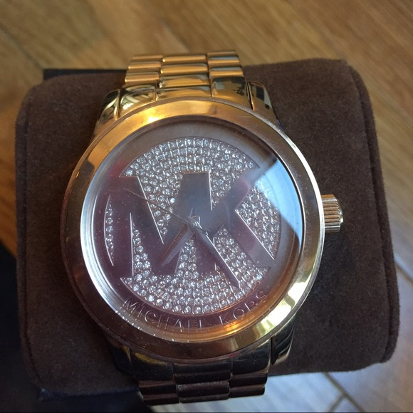 00797ee7ae0a Michael Kors Ross gold with diamond watch.