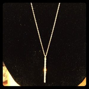 Jewelry - Long gold-toned w crystals inlaid in a gold bar