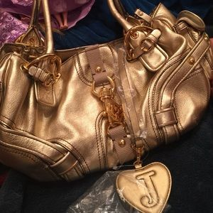 Juicy Couture Handbags - New juicy leather hold bag