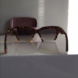 24318bec2640 Miu Miu Accessories - Miu Miu SMU 11OS Rasoir Semi-Rimless Sunglasses