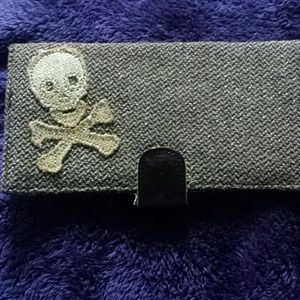 Brown and gold skull and bones wallet